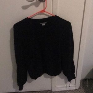 I am selling a nice knit black sweater.